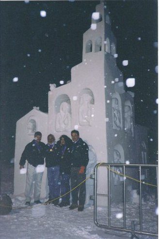 "Breckenridge, Colorado - Mexican sculptor Abel Ramírez Águilar posing with other members of team Graciela Ferreiro, Gabriel Rayar and Robert Hancock in front of their snow sculpture ""Little Village"" at the International Snow Sculpture Championships in 1999"
