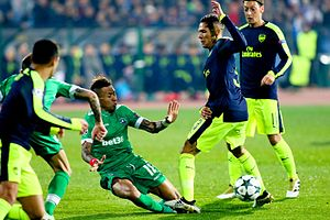 2016–17 Arsenal F.C. season - Kieran Gibbs attempts evasion of a challenge at Ludogorets Razgrad in the UEFA Champions League.