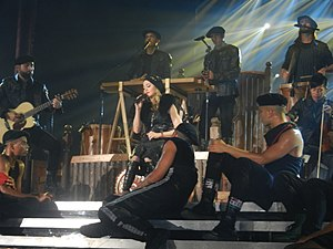 """Masterpiece (Madonna song) - Madonna, flanked by her dancers and the Kalakan trio at the back, performs """"Masterpiece"""" during The MDNA Tour."""