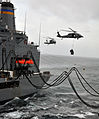 MH-60 Seahawk helicopters transfers supplies while the fleet replenishment oiler USNS Rappahannock (T-AO 204) transfers fuel to the amphibious assault ship USS Boxer (LHD 4) during an under way replenishment 110317-N-ZS026-076.jpg