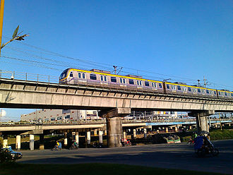 Manila Light Rail Transit System Line 2 - A westbound LRT-2 train on the viaduct near Marikina River towards Santolan station