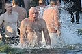 Man swims in cold water (34807325734).jpg