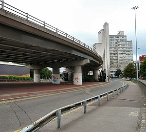 Mancunian Way - View west at the eastern terminus of the A57(M), from the north of the junction (with the A6 London Road), showing the Maths and Social Sciences Building (former UMIST), and proximate to the Macdonald Manchester Hotel