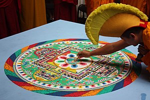 Tibetan culture - Tibetan Gelug monk and Sand mandala