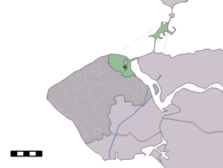 The village centre (dark green) and the statistical district (light green) of Vrouwenpolder in the municipality of Veere.