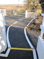 Maryburgh level crossing (13175288873).jpg