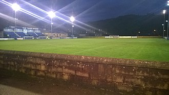 Matlock Town F.C. - Main stand and bar/function area at far end. Riber Castle can be seen in the top right.