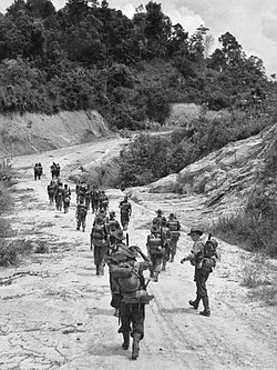 Members of B Company of the 2-2 Machine Gun Battalion moving along a road towards Brunei AWM 109273.jpg