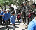 Members of the Afghan Air Corps provide much needed school supplies to a school about 2 miles north of Kabul International Airport (4677749455).jpg