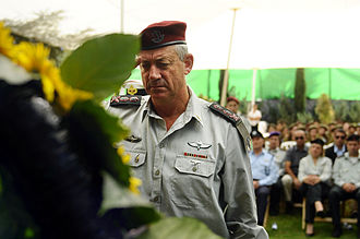 Ceremony - Israel Defense Forces Chief of Staff Lt. Gen. Benny Gantz salutes Yom Kippur War casualties at an official annual memorial service.