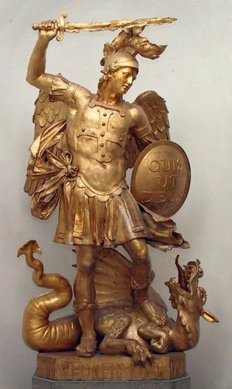 "Deus - Statue of Archangel Michael slaying Satan represented as a dragon. Quis ut Deus? (""Who is like God?"") is inscribed on his shield."