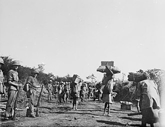 Chilembwe uprising - Nyasa porters, watched by British soldiers, during the East African campaign