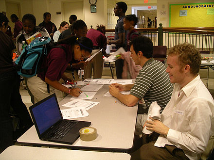 Students volunteer at a D.C. inner-city school Money Matters at TMA.jpg