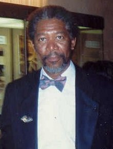 Morgan Freeman facing the camera in a tuxedo and bowtie