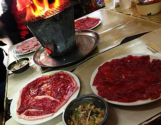 Korean-Chinese style barbecue in mud brazier (Ni Lu Shao Kao ) is exclusively in Shenyang Mud Brazier BBQ in Shenyang.jpg