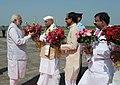 Narendra Modi being received by the Governor of Madhya Pradesh, Shri Ram Naresh Yadav and the Chief Minister of Madhya Pradesh, Shri Shivraj Singh Chouhan, on his arrival at Bhopal, in Madhya Pradesh on September 10, 2015.jpg