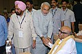 Narendra Modi meeting with the Chief Minister of Tamil Nadu, Shri M. Karunanidhi at the 53rd meeting of the National Development Council (NDC) on the Agriculture & Allied Sectors, in New Delhi on May 29, 2007.jpg