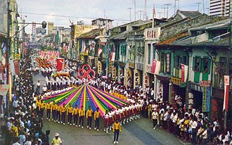 Singapore National Day Parade - A scene from the National Day Parade, 1968, with a contingent from the People's Association in front.