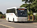 National Express coach Veolia Transport Volvo B12B Caetano FJ06 GHA National Express livery.jpg