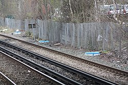 New concrete drain surround at Bromborough station (26872795881).jpg