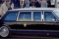 New president George H.W. Bush, in presidential automobile, waves to the crowd on Pennsylvania Avenue during his inaugural parade on January 20, 1989, Washington, D.C LCCN2011632652.tif