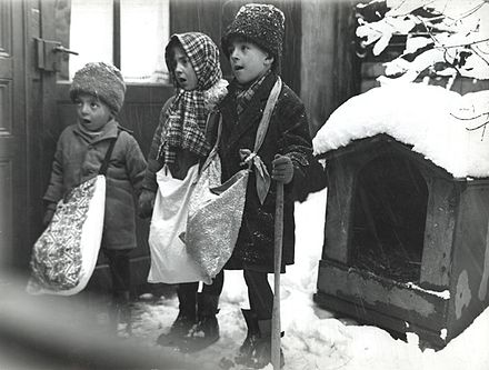 Child Christmas carolers in Bucharest, Romania 1929 Nicolae Ionescu - Children carolers in Bucharest, 1929.jpg