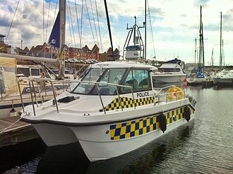 North West Police Underwater Search and Marine Unit - A Cheetah catamaran acquired by the Unit in 2012, to be used during the London Olympics.