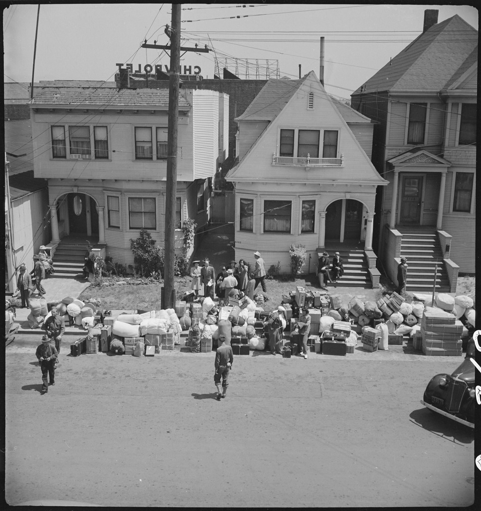 http://upload.wikimedia.org/wikipedia/commons/thumb/e/eb/Oakland%2C_California._Baggage_of_evacuees_of_Japanese_ancestry_piled_on_the_sidewalk._The_Greyhound_._._._-_NARA_-_537701.tif/lossy-page1-965px-Oakland%2C_California._Baggage_of_evacuees_of_Japanese_ancestry_piled_on_the_sidewalk._The_Greyhound_._._._-_NARA_-_537701.tif.jpg