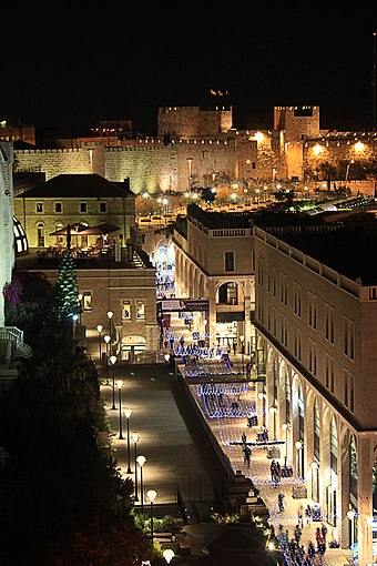"Mamilla Mall adorned with upscale shops adjacent to the Old City Walls. Old city walls and mamilla ave. at night - as seen from ""Rooftop"" restauran - Jerusalem, Israel.jpg"