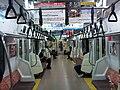 Ome Line E233 series interior 20101007.jpg