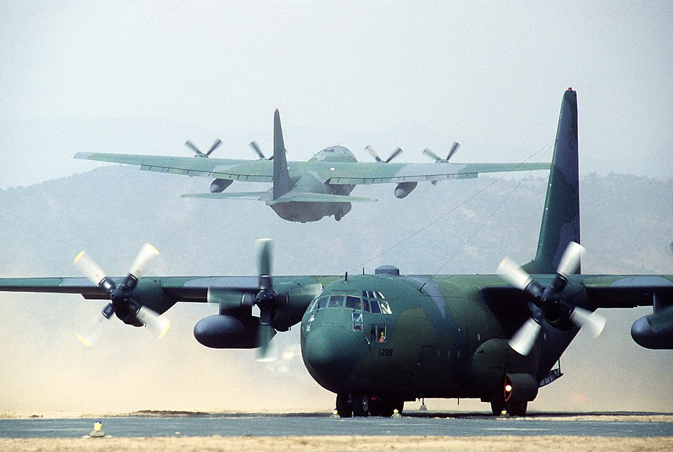 One U.S. Air Force C-130 Hercules aircraft taxis as another takes off from Yeo Ju airstrip during the joint U.S.-South Korean Exercise Team Spirit %2784 DF-ST-84-11567