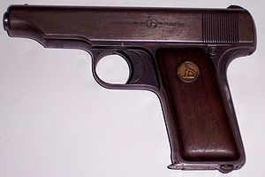 Safety (firearms) - Ortgies pistol with grip safety engaged, visible extending right from the upper part of the grip. When disengaged (in), it remains latched until the button under the slide is depressed.