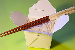 Oyster pail - An opened, plain oyster pail of white rice, with chopsticks