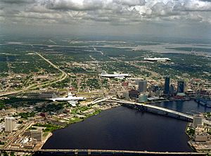 P-3 Orion aircraft from NAS Jacksonville overfly downtown Jacksonville and three of its road bridges, 1994.