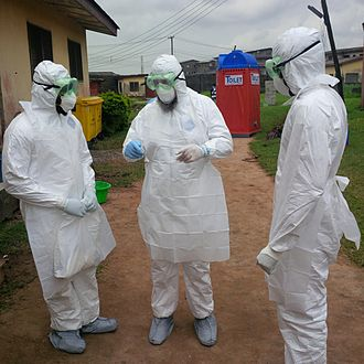 West African Ebola virus epidemic - Nigerian doctors receive training on how to use protective clothing by the World Health Organization.