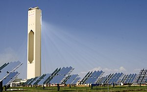 Solar power in India - Solar thermal power plant with a field of heliostats and a central solar power tower.