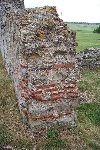 Reculver - Part of the south wall of the 7th-century church, incorporating Roman tiles
