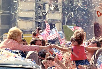 Pat Nixon reaches out to young girl
