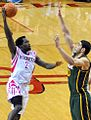 Patrick Beverley goes up for a shot against Enes Kanter (cropped).jpg