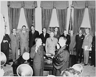 Hoffman being sworn in as administrator of the Economic Recovery Corporation (1948) Paul Hoffman is sworn in by Chief Justice Fred Vinson as administrator of the Economic Recovery Corporation in a... - NARA - 199759.jpg
