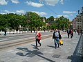 Pedestrians and tramway on bridge (18620835428).jpg