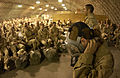 Personnel recently assigned to the 410 Air Expeditionary Wing, at a forward deployed location, attend a readiness training briefing 030228-F-VY627-002.jpg