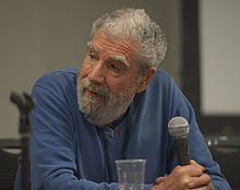 Photograph of Peter Nicholls sitting during a panel discussion