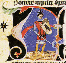 An armed men, wearing a sword and a shield depicting a bird of prey