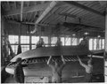 Placing fabricated underbody planking on hull - NARA - 298554.tif