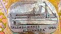 Plakette mit der Form vom Salondampfer Alexandra mit Blindenschrift an der Hafenspitze in Flensburg - panoramio.jpg
