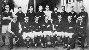 A group of footballers posing for a team photograph.