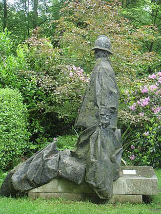 """King's Cross fire - Ivor Roberts-Jones RA created this statue to commemorate the policemen who lost their lives in the fire at King's Cross in 1987. The statue is named """"Policeman"""" and stands in the gardens at Renishaw Hall."""