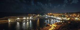 El Kala - The old fishing harbor of El Kala by night. A trade-oriented harbor is under construction in the western side of town.