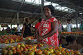 Portrait of a woman at Honiara Central Market selling Tomatoes. (10714202244).jpg